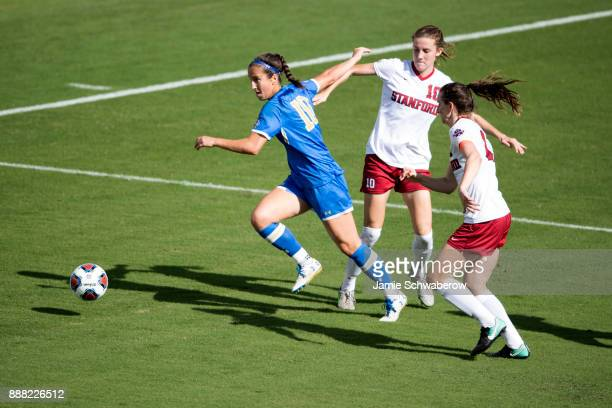Julia Hernandez of UCLA and Tierna Davidson and Andi Sullivan of Stanford University battle for the ball during the Division I Women's Soccer...