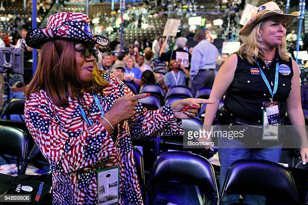 Julia Hicks a delegate from Colorado Ann Zucker dances during day one of the 2008 Democratic National Convention in Denver Colorado US on Monday Aug...