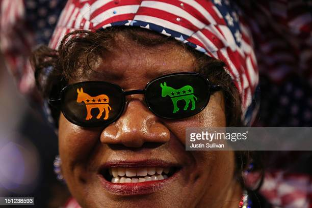 Julia Hicks wears glasses with Democratic donkeys on them during day one of the Democratic National Convention at Time Warner Cable Arena on...