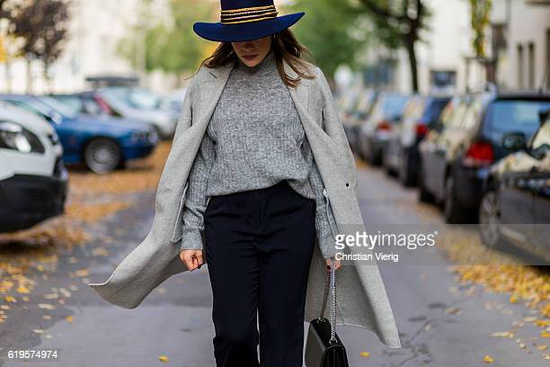 Julia Isabella Kuhne wears a grey ZARA wool coat grey knitted jumper from HM Trend black pants ZARA black bag Agneel navy hat Ueterque on October 31...
