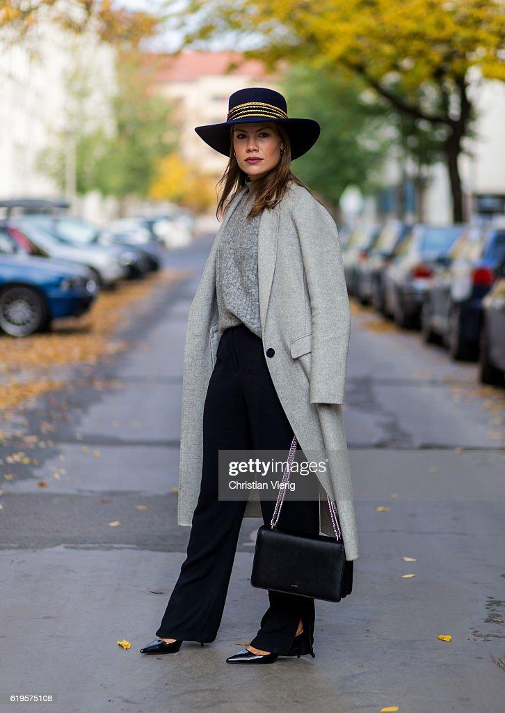 Julia Isabella Kuhne (@sophisticatedisabella) wears a grey ZARA wool coat, grey knitted jumper from H&M Trend, black pants ZARA, black slingback pumps: ZARA, black bag Agneel, navy hat Ueterque on October 31, 2016 in Berlin, Germany.