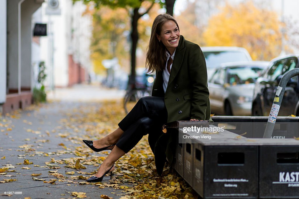 Julia Isabella Kuhne (@sophisticatedisabella) wears a khaki coat from Ivy & Oak, white blouse from H&M Trend, black pants from ZARA, black slingback pumps from ZARA, Louis Vuitton bag clutch on October 31, 2016 in Berlin, Germany.
