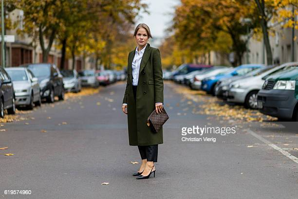 Julia Isabella Kuhne wears a khaki coat from Ivy Oak white blouse from HM Trend black pants from ZARA black slingback pumps from ZARA Louis Vuitton...