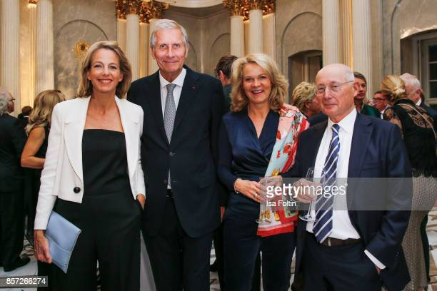 Julia Jaeckel and her husband German news anchor Ulrich Wickert Karin HinrichsAust and her husband German presenter Stefan Aust during the ReOpening...