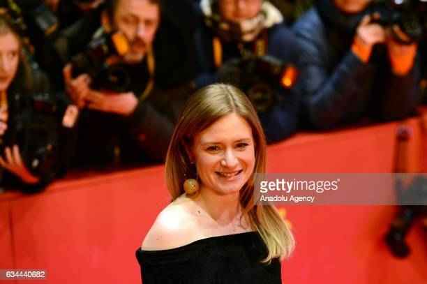 Julia Jentsch poses on the red carpet during opening ceremony of the 67th Berlinale International Film Festival at Grand Hyatt Hotel in Berlin...