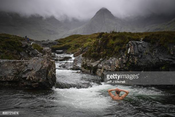 Julia Johansson from Finland swims in the Fairy Pools on the Isle of Skye on August 18 2017 in Glenbrittle Scotland The Isle of Skye is known as one...