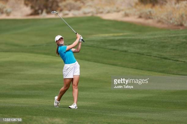 Julia Johnson of the Ole Miss Rebels hits her approach shot during her match during the Division I Women's Golf Championship held at the Grayhawk...