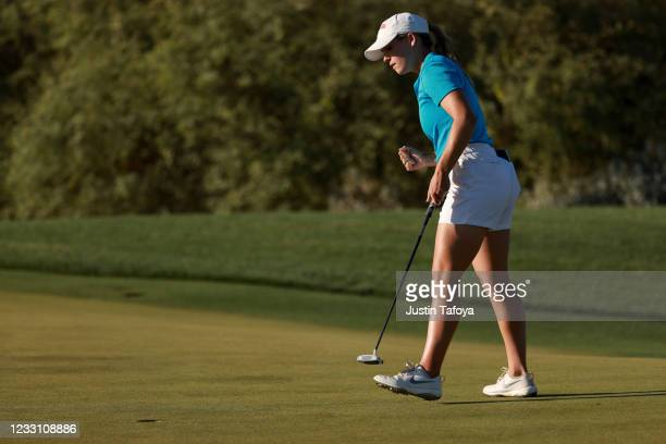 Julia Johnson of the Ole Miss Rebels reacts to a made putt in her match during the Division I Women's Golf Championship held at the Grayhawk Golf...