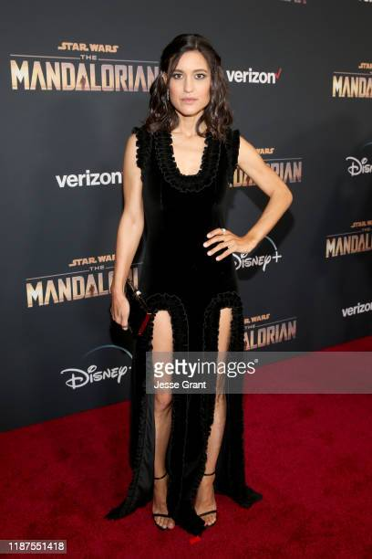 Julia Jones arrives at the premiere of Lucasfilm's firstever liveaction series The Mandalorian at the El Capitan Theatre in Hollywood Calif on...