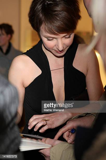 Julia Koschitz gives autogramms at the 'Ruhm' Germany Film Premiere at 'Residenz eine astor Film Lounge' on March 20 2012 in Cologne Germany