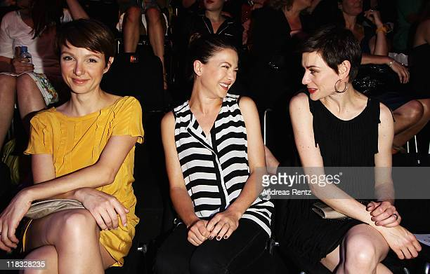 Julia Koschitz Hannah Herzsprung and Christiane Paul sit in front row at the Strenesse Blue Show during MercedesBenz Fashion Week Berlin...