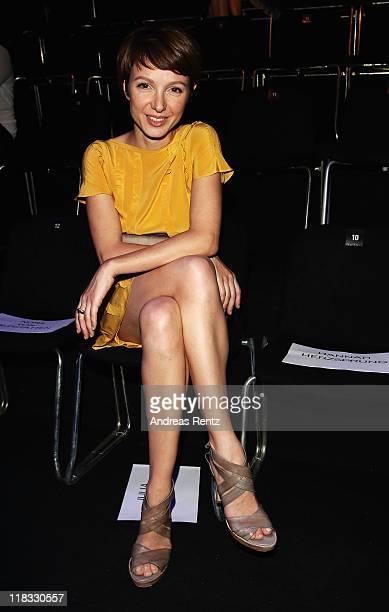 Julia Koschitz sits in front row at the Strenesse Blue Show during MercedesBenz Fashion Week Berlin Spring/Summer 2012 at the Brandenburg Gate on...