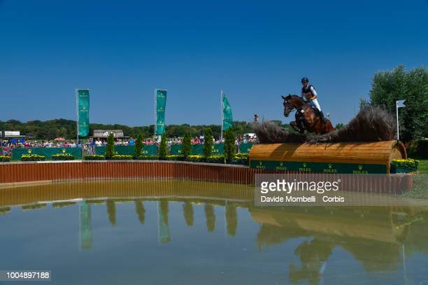 Julia Krajewski of Germany riding Chipmunk FRH during the obstacle in the water of the Cross Country test DHLPrize in the park of the CHIO of Aachen...