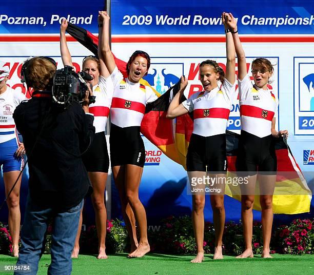 Julia Kroeger Laura Tibitanzl Helke Nieschlag and Lena Mueller of Germany celebrate winning the Women's Lightweight Quadruple Sculls during the World...