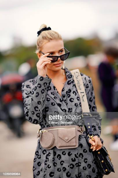Julia Kuczynska Maffashion wears a blazer jacket sunglasses a Dior bag a belt bag outside Dior during Paris Fashion Week Womenswear Spring/Summer...