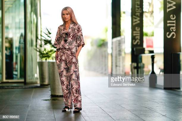 Julia Kuczynska Maffashion wears a floral print full outfit after the CDG Comme des Garcons show during Paris Fashion Week Menswear Spring/Summer...