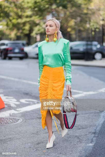 Julia Kuczynska wearing green top yellow skirt Gucci bag seen in the streets of Manhattan outside Zimmermann during New York Fashion Week on...