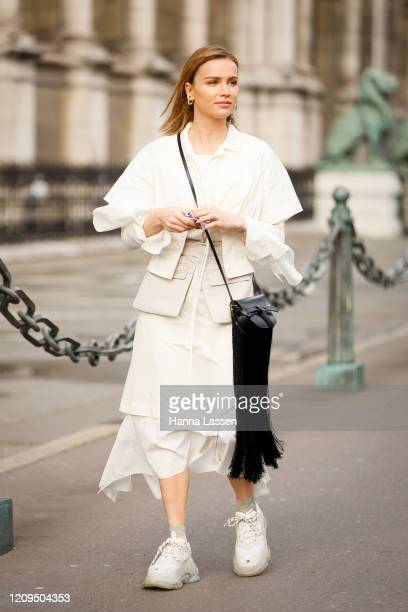 Julia Kuczynska wearing white blouse, white midi skirt, Balenciaga sneakers outside Vivienne Westwood show during Paris Fashion week Womenswear...