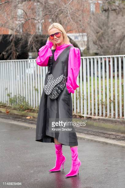 Julia Kuczynska wears Balenciaga boots Dior bag Carrera sunglasses and a Cos dress and shirt on March 01 2019 in Paris France