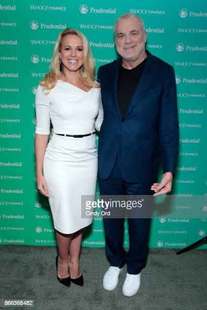 Julia La Roche and Aetna Chairman CEO Mark Bertolini attend the Yahoo Finance All Markets Summit on October 25 2017 in New York City