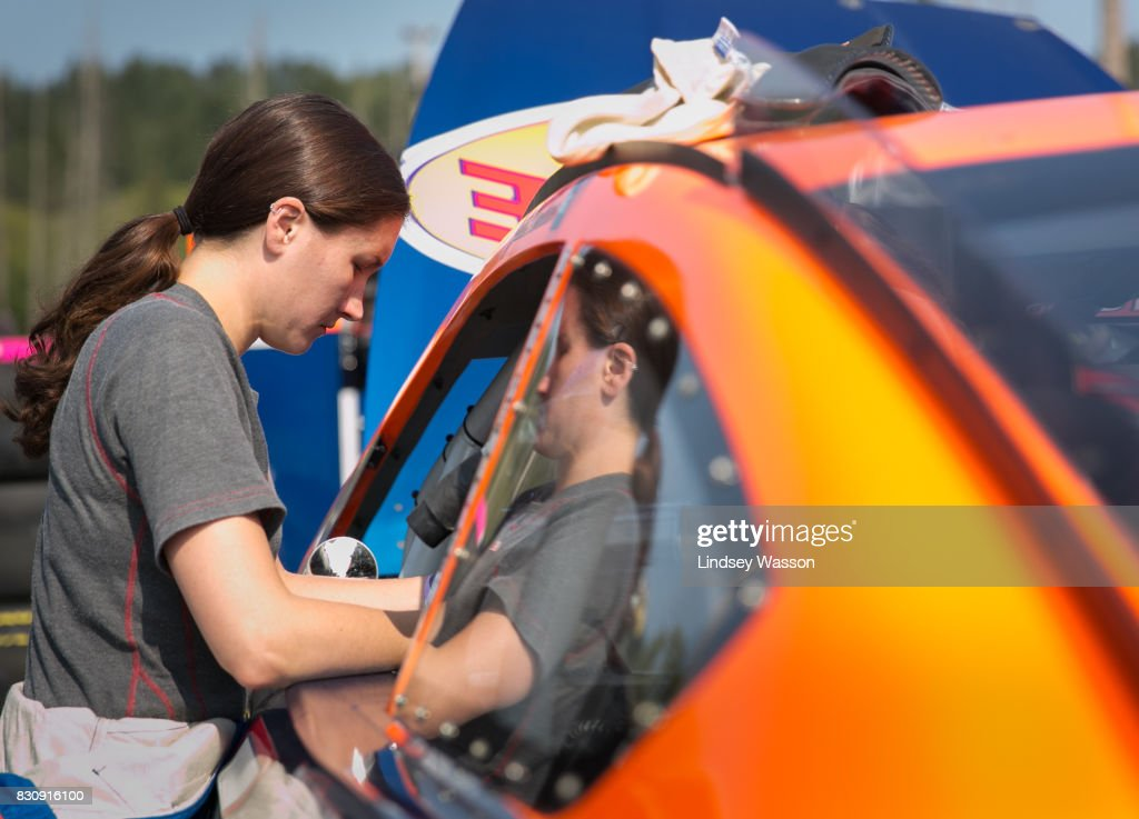 Julia Landauer #6 checks inside her vehicle during final practice before the NASCAR K&N Pro Series West NAPA Auto Parts 150 on August 12, 2017 at Evergreen Speedway in Monroe, Washington.