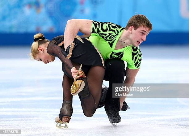 Julia Lavrentieva and Yun Rudyk of Ukraine compete in the Figure Skating Pairs Short Program during the Sochi 2014 Winter Olympics at Iceberg Skating...