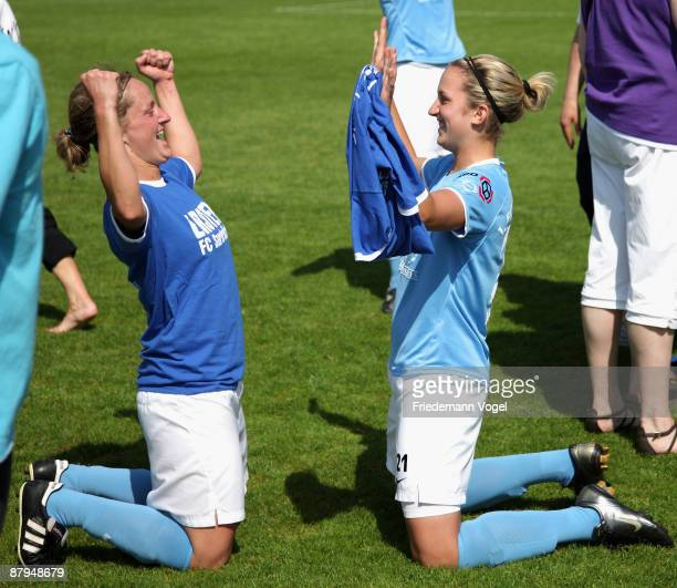 Julia Leykauf and Laura Vetterlein of Saarbruecken celebrate the ascension to the First Bundesliga after winning the Women's 2 Bundesliga match...