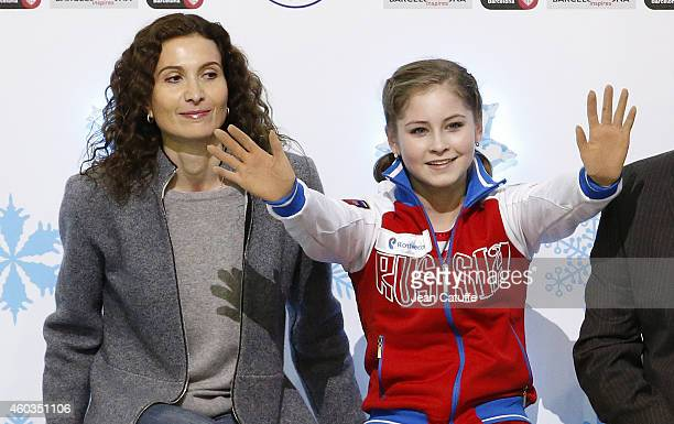 Julia Lipnitskaia of Russia and her coach Eteri Tutberidze await for the results during the Ladies Short Program Final on day one of the ISU Grand...