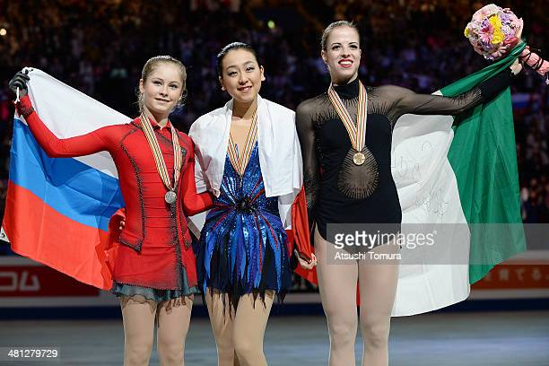Julia Lipnitskaia of Russia, Mao Asada of Japan and Carolina Kostner of Italy pose with medal in the victory ceremony during ISU World Figure Skating...