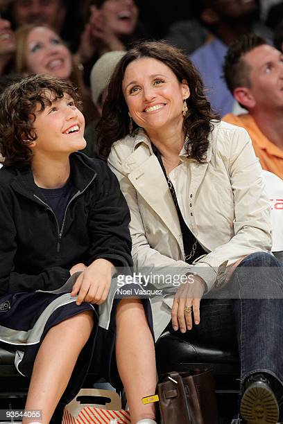 Julia Louis Dreyfus and her son Charles attend a game between the New Orleans Hornets and the Los Angeles Lakers at Staples Center on December 1 2009...