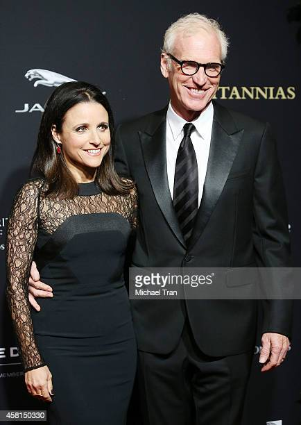 Julia LouisDreyfus and Brad Hall arrive at the BAFTA Los Angeles Jaguar Britannia Awards held at The Beverly Hilton Hotel on October 30 2014 in...
