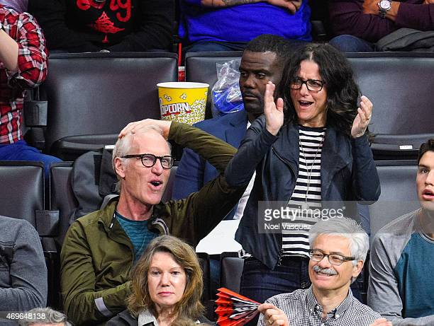 Julia LouisDreyfus and Brad Hall attend a basketball game between the Denver Nuggets and the Los Angeles Clippers at Staples Center on April 13 2015...