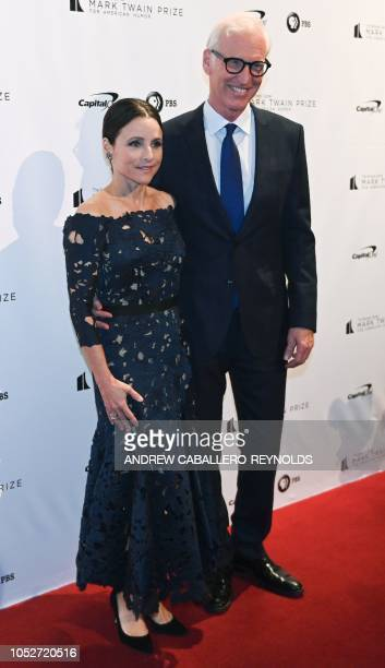 Julia LouisDreyfus and her husband Brad Hall pose on the red carpet for the 21st Annual Mark Twain Prize for American Humor at the Kennedy Center in...