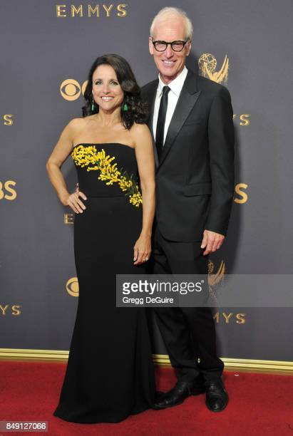 Julia LouisDreyfus and husband Brad Hall arrive at the 69th Annual Primetime Emmy Awards at Microsoft Theater on September 17 2017 in Los Angeles...