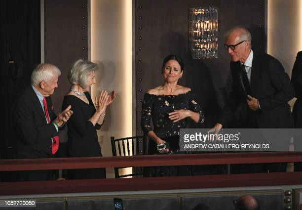 Julia LouisDreyfus her husband Brad Hall at her side reacts as she arrives during the show for the 21st Annual Mark Twain Prize for American Humor at...