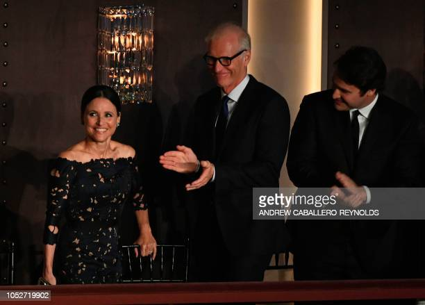 Julia LouisDreyfus is cheered by her husband Brad Hall as she arrives during the show for the 21st Annual Mark Twain Prize for American Humor at the...