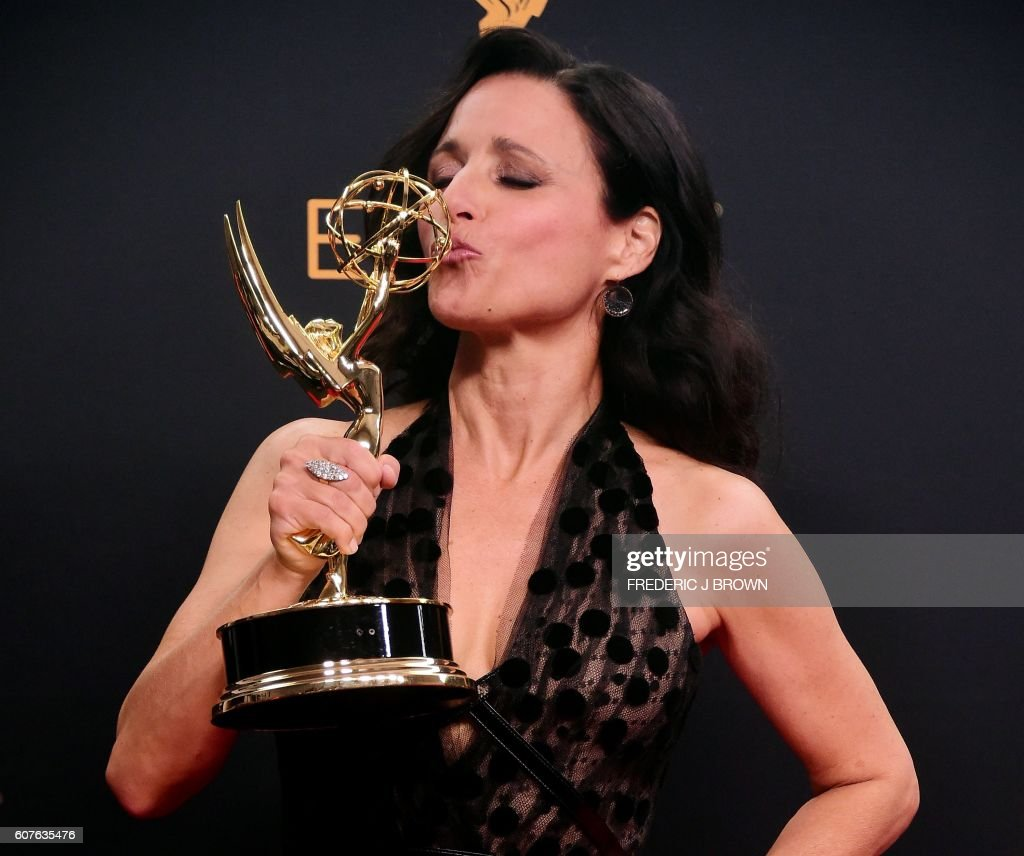 TOPSHOT - Julia Louis-Dreyfus poses in the press room with the Emmy for Outstanding Lead Actress in a Comedy Series for 'Veep' during the 68th Emmy Awards on September 18, 2016 at the Microsoft Theatre in downtown Los Angeles. /