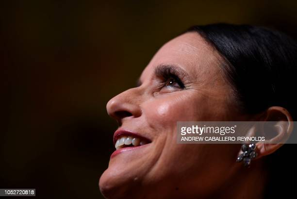 Julia LouisDreyfus speaks with reporters on the red carpet for the 21st Annual Mark Twain Prize for American Humor at the Kennedy Center in...