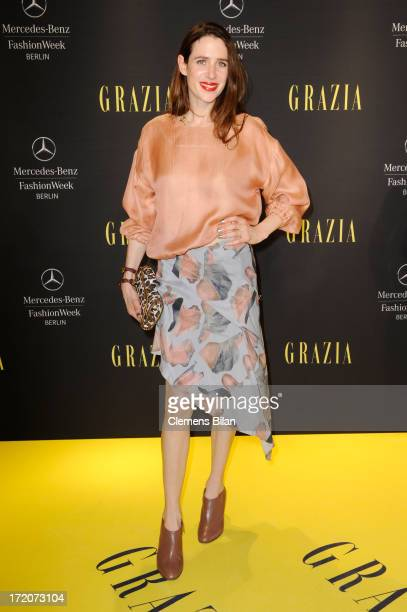 Julia Malik attends the MercedesBenz Fashion Week Berlin Spring/Summer 2014 Preview Show by Grazia at the Brandenburg Gate on July 1 2013 in Berlin...