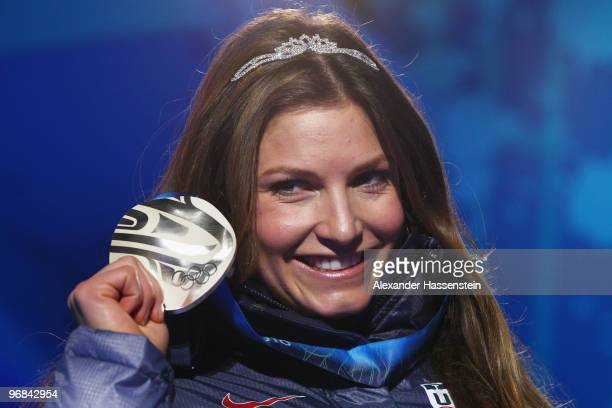 Julia Mancuso of the United States celebrates receiving her silver medal during the medal ceremony for the Alpine Skiing Ladies Downhill on day 6 of...