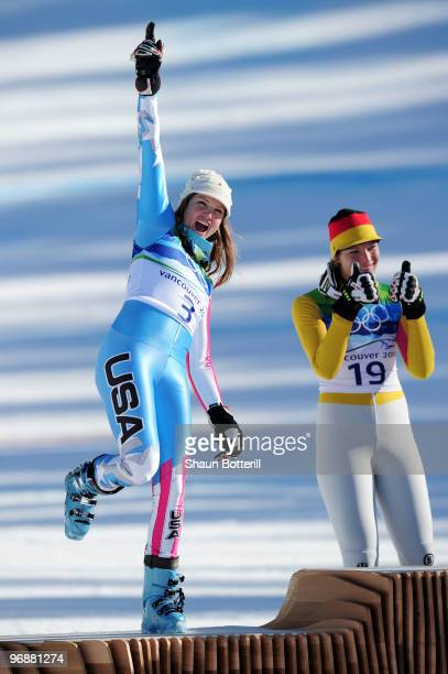 Julia Mancuso of The United States celebrates silver during the flower ceremony for the women's super combined alpine skiing on day 7 of the...