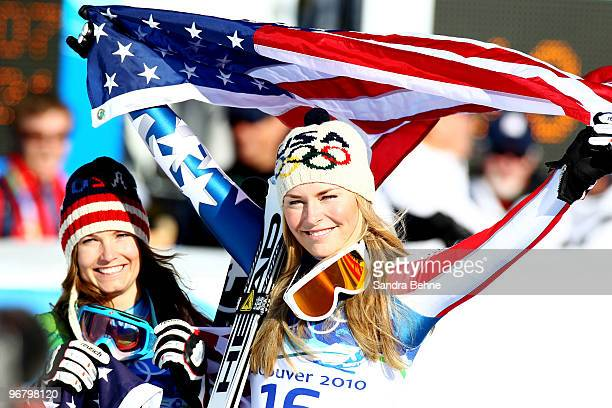 Julia Mancuso of the United States celebrates winning silver and Lindsey Vonn of the United States gold during the flower ceremony for the Alpine...