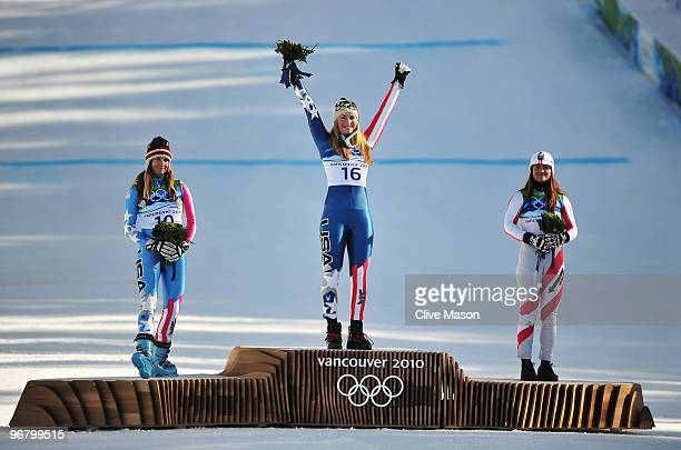 Julia Mancuso of the United States celebrates winning silver Lindsey Vonn of the United States gold and Elisabeth Goergl of Austria bronze during the...