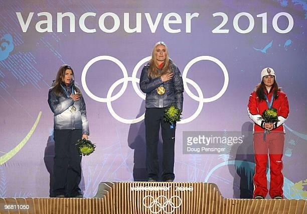 Julia Mancuso of the United States celebrates winning silver, Lindsey Vonn of the United States gold and Elisabeth Goergl of Austria bronze during...