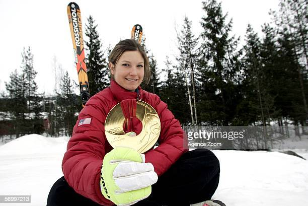 Julia Mancuso of the United States poses with her Torino 2006 giant slalom gold medal during the FIS Skiing World Cup Women's Super-G on March 3,...
