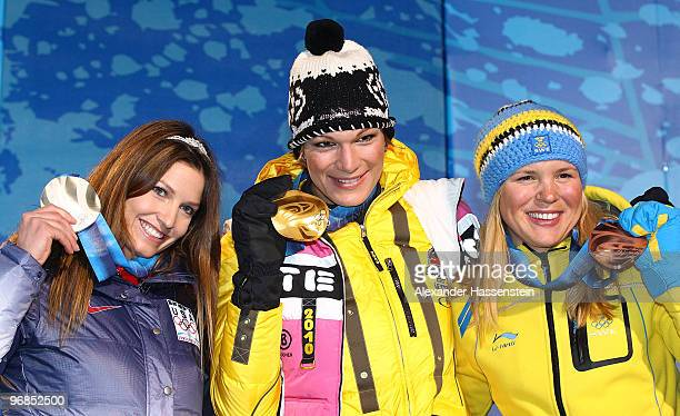 Julia Mancuso of the United States Silver Maria Riesch of Germany Gold and Anja Paerson of Sweden Bronze celebrate during the medal ceremony for the...