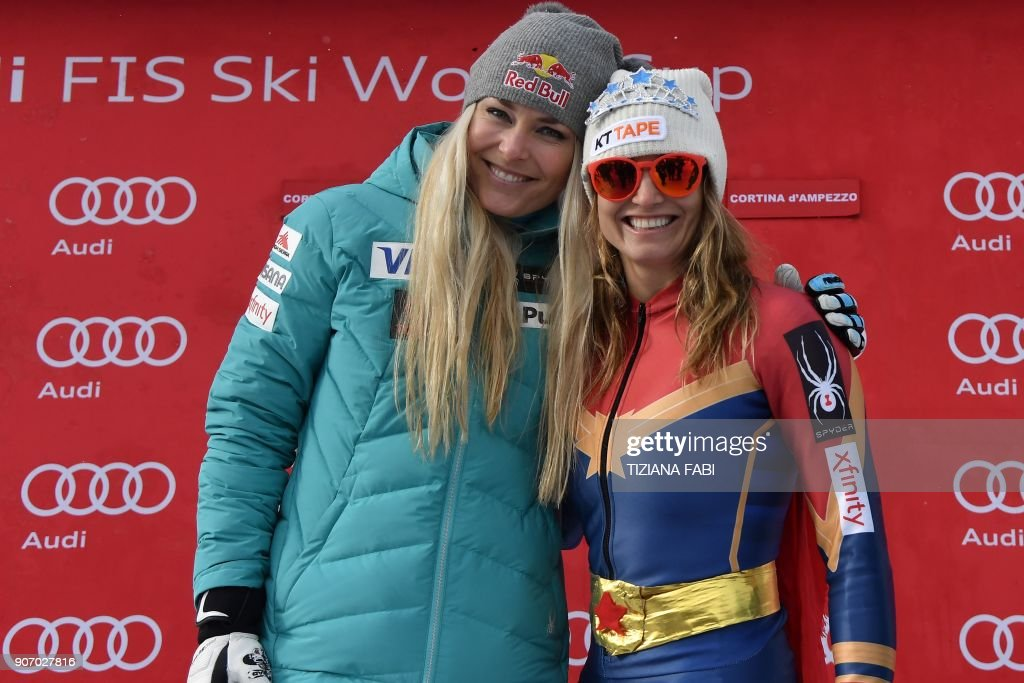 Julia Mancuso (R) of the USA wearing a 'Wonder Woman' ski suit poses with US teammate Lindsey Vonn after the FIS Alpine World Cup Women's Downhill replacing Val d'Isere event on January 19, 2018 in Cortina d'Ampezzo, Italian Alps. Four-time Olympic medallist Julia Mancuso has announced she will retire from alpine skiing after a farewell run in the women's World Cup downhill in Cortina d'Ampezzo. (L) Lindsey Vonn The 33-year-old American has battled a degenerative hip problem and failed to qualify for a fifth Winter Olympics in South Korea next month. PHOTO / Tiziana FABI