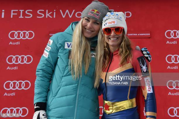 Julia Mancuso of the USA wearing a Wonder Woman ski suit poses with US teammate Lindsey Vonn after the FIS Alpine World Cup Women's Downhill...