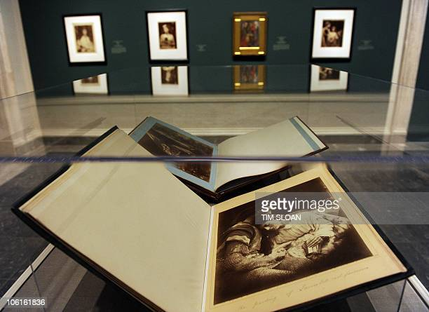Julia Margaret Cameron's The Parting of Lancelot and Guinevere albumen print in bound volumes part of the new exhibit The PreRaphaelite Lens British...