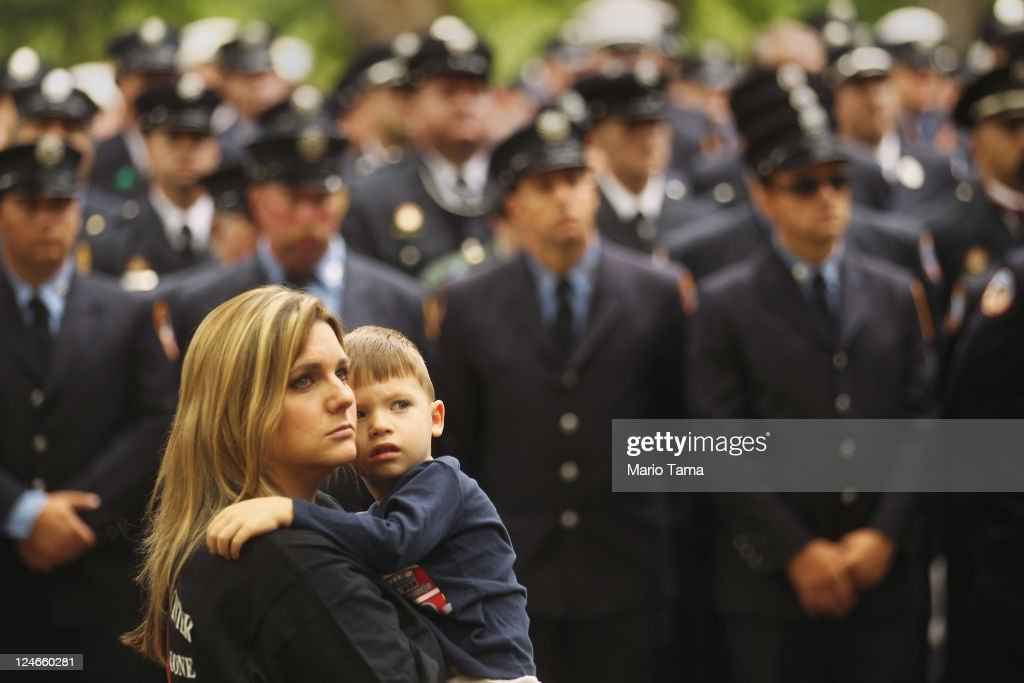 Julia McCallister, wife of Martin County, Florida Fire Rescue firefighter Sean McCallister, holds son Sean at a memorial service for firefighters killed on 9/11 at the Firemen's Monument at Riverside Park on Septemnber 11, 2011 in New York City. Firegihters from around the world have converged on New York to take part in the anniversary services. New York City and the nation are commemorating the tenth anniversary of the terrorist attacks which resulted in the deaths of nearly 3,000 people after two hijacked planes crashed into the World Trade Center, one into the Pentagon in Arlington, Virginia and one crash landed in Shanksville, Pennsylvania.